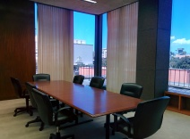 A small conference room in the Peirera corporate HQ