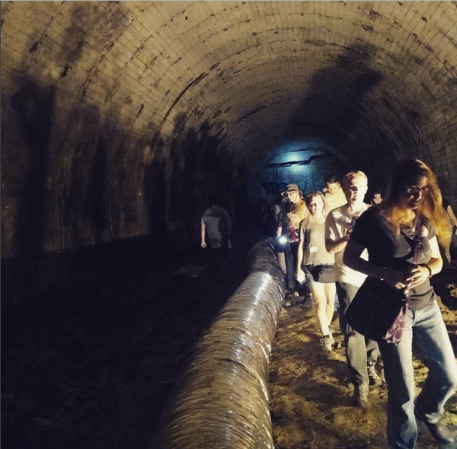 Tunnel tourists take a trek.